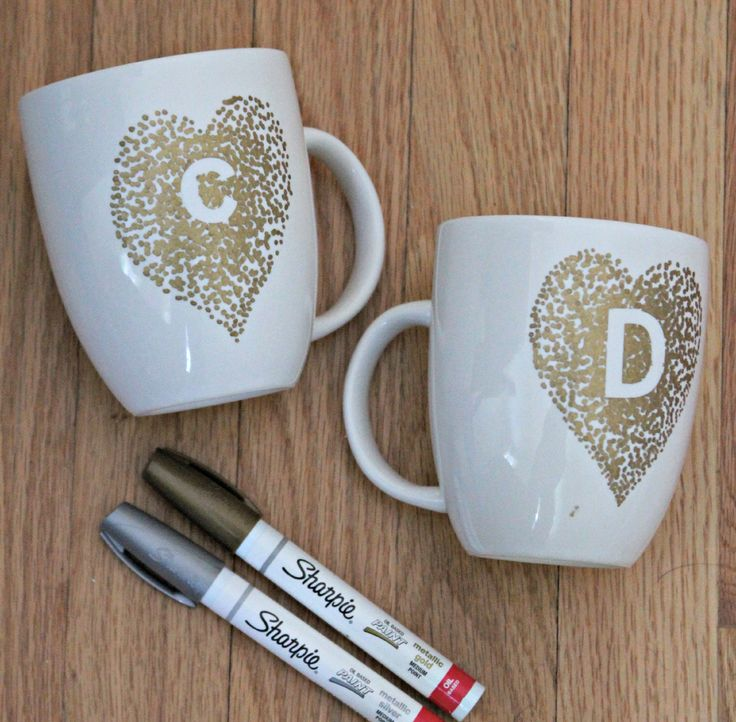 DIY Paint Pen Mugs -- Great gift. Buy a white mug, some initial stickers and go to town! #monogram #tutorial #DIY