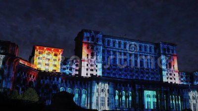 House of Parliament night at Bucharest, Romania - facade to Constitution Square and projection lights at Bucharest Days.