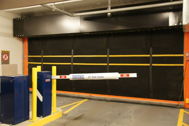Wilcox Parking Garage Doors    Model HDT    High Traffic Roll Up Doors Examples of Applications: manufacturing, food processing, automotive, bus transit stations, parking garages, postal, airports and railways    - Suitable for applications up to 20 feet in width or height.