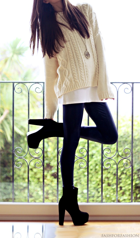 thick heels, leggings, and a sweater.