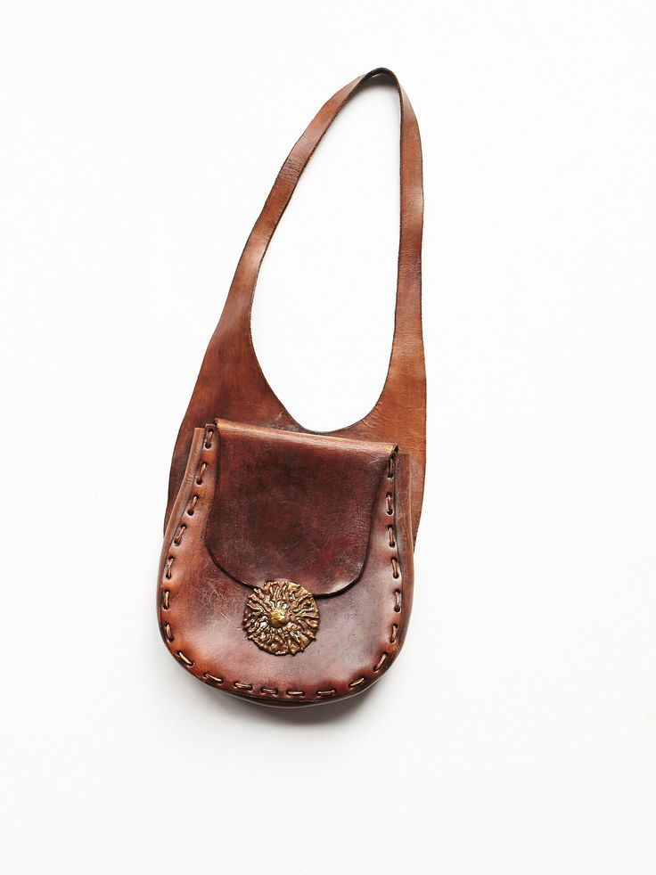 Vintage '70s Brown Leather Bag | 1970s brown leather bag with ornate brass buckle.  *Vintage pieces should be handled with love. Dry Clean or Hand Wash.