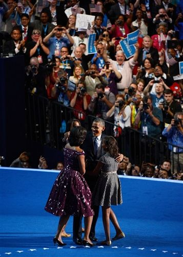 President Barack Obama stands with his family First lady Michelle Obama, Malia Obama, and Sasha Obama during the final day of the Democratic National Convention at Time Warner Cable Arena on September 6, 2012 in Charlotte, North Carolina. (Photo: Kevork Djansezian / Getty Images) #NBCPolitics