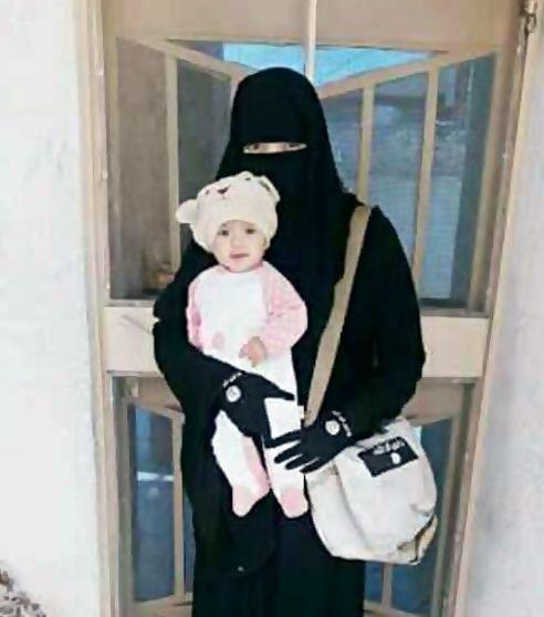 Ninja terrorist holding a baby.