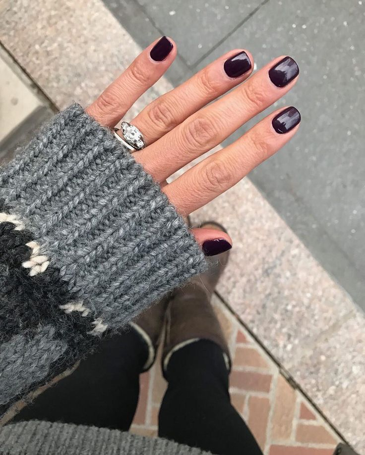 """Arctic tundra temps have got us crossing over to the dark side. Since we missed #ManiMonday  we're making our own """"Tips Tuesday"""" just to share this shot of @racheljosilver wearing the vampy @oribe The Lacquer High Shine Nail Polish in The Violet"""