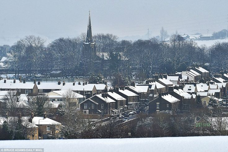 This wintry scene shows lines of houses coated in thick snow in New Mills, Derbyshire foll...