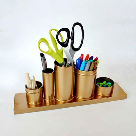 Learn how to make your own DIY pencil holder here: http://www.bhg.com/decorating/do-it-yourself/accents/DIY-decor-that-looks-like-the-real-deal/#page=15 All you need are some soup cans, a shot glass, tea canisters, and a wood plank!