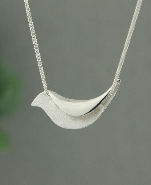 Sterling silver necklace with sweet bird pendant to help you take sing your own song. Made in Thailand.