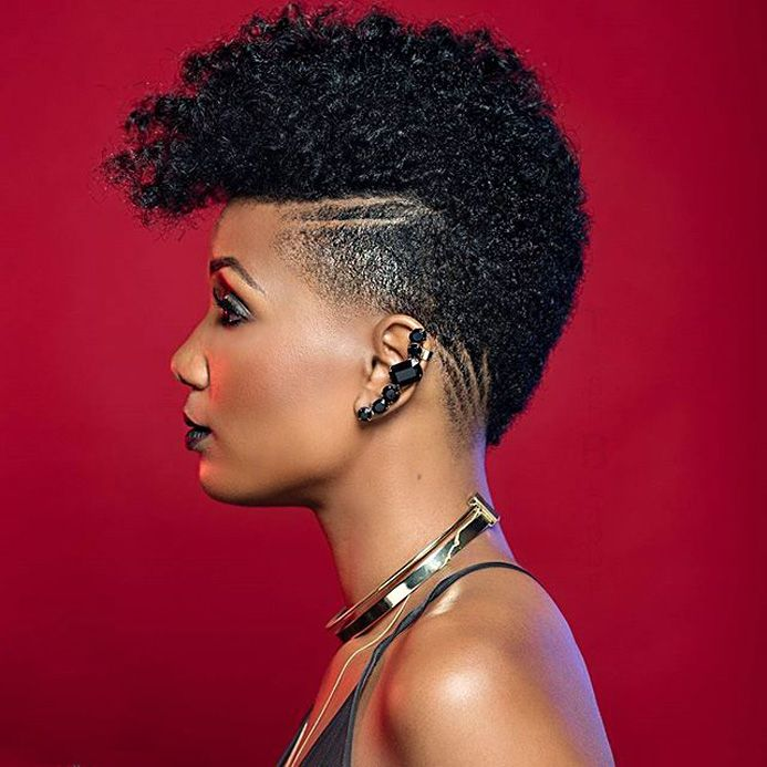 Afrohawk, curly natural hairstyle inspiration, afro hair with undercut, black girl stylin', short haircut.