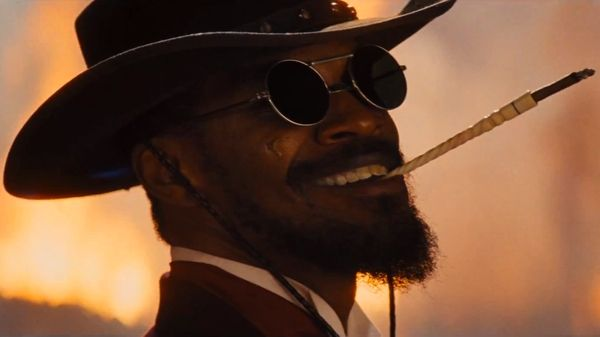 Badass smile, I'd say, and I love it. Jamie Foxx in Django Unchained