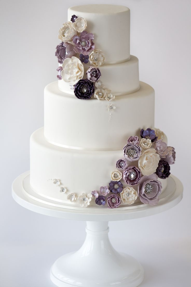 Amy Beck Cake Design - Chicago, IL | Wedding cake with purple and ivory stylized sugar flowers with vintage brooches. www.amybeckcakedesign.com |  #weddingcake #purpleflowers #sparkly #amybeckcakedesign