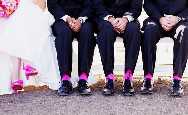 L O V E THIS PIC, wedding picture where the grooms men has socks that matches the brides shoes.