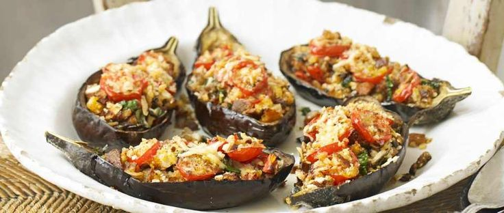 Growing up, aubergines were plentiful in summer in Italy, and a very popular vegetable in the south. We would slice them and simply grill or bake them, or we'd make the famous melanzane alla parmigiana – sliced and baked in a tomato sauce with mozzarella and parmesan. A nice way with them is to stuff and bake them, as in this recipe. It is delicious served with a salad for lunch or supper.