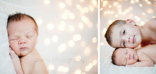 newborn baby and brother with christmas lights bokeh photography by zoedennis, via Flickr