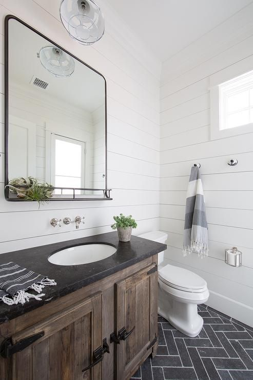 Black Rustic Bathroom Vanity: Slate Herringbone Floor Tiles Frame A Rustic Wood