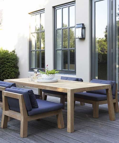 Oh dinner with family and friends would be wonderful on this patio. I am loving the table and chairs...