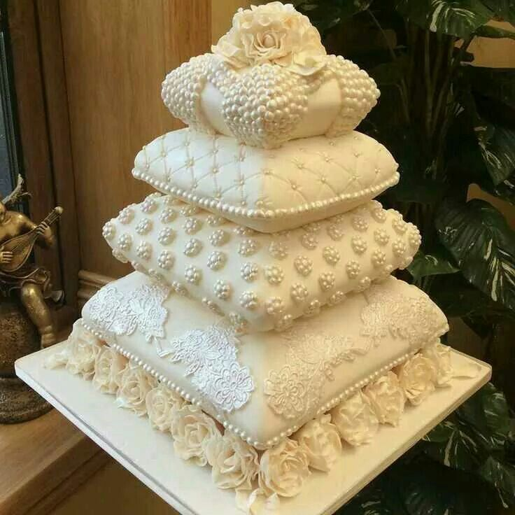 Beautiful tiered pillow shaped wedding cake