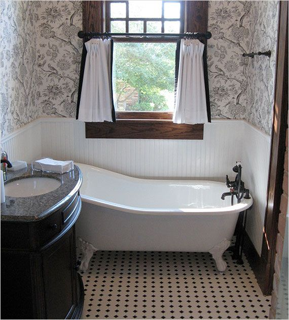 craftsman style is beautifully expressed in this bathroom with the big window standalone tub