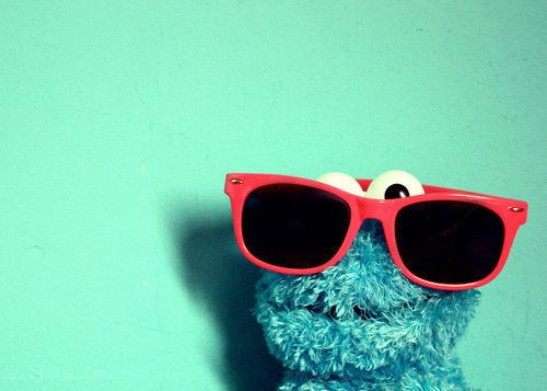 Sun glasses make you cool :)No cookie monster was already cool.