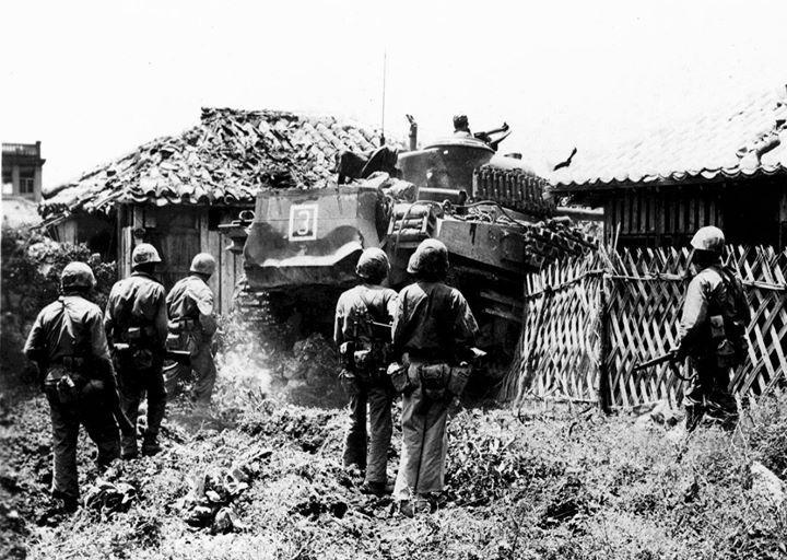 Men of US Marine Corps 6th Division entering Naha Okinawa 17 May 1945.