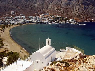 Kamares beach, Sifnos. Best beach in the world, IMHO. One of the longest beaches in the Cyclades, shallow enough so you don't have to worry about your kids, with tavernas & cafes bordering it.