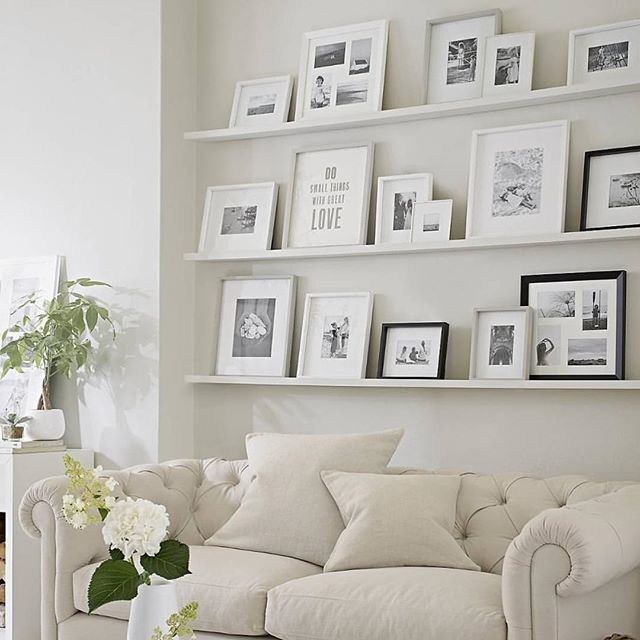 Happy Monday!!! I just got home from shopping Valentines and plopped down to say hey! (That's #widn thanks @randigarrettdesign (she's AMAZING!!)) @thewhitecompany nailed it with this couch and gallery wall combo.... #iwant @studio7interiors @kelleynan what are you beauties up to?                                                                                                                                                      More