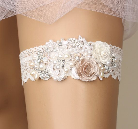 there is a beautiful range of bridal garters in this fabulous Australian store on Etsy. wedding garter bridal garter lace garter white by GadaByGrace