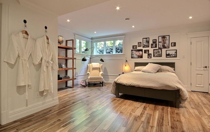 Beautiful guest bedroom featuring Lauzon's Organik Hard Maple hardwood flooring Charm. This flooring features the exclusive air-purifying technology called Pure Genius technology. Project realized by Brigitte Lafleur. #interiordesign #hardwoodfloor #artfromnature