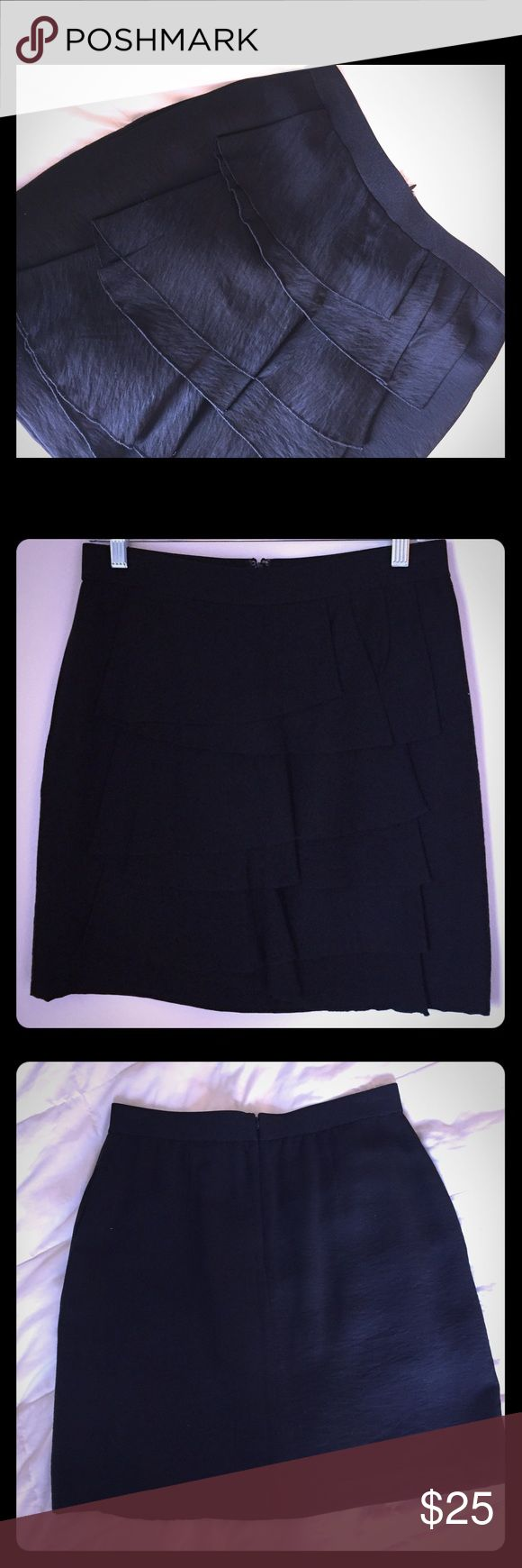 """Black BCBG Ruffled Mini Skirt Beautiful black BCBG Maxazria mini skirt. Front ruffle detail adds a simple pop to a classic black skirt. Has side pockets and a back zipper. 15"""" at the waist and 19"""" top to bottom. Excellent condition only worn a couple times. BCBGMaxAzria Skirts Mini"""