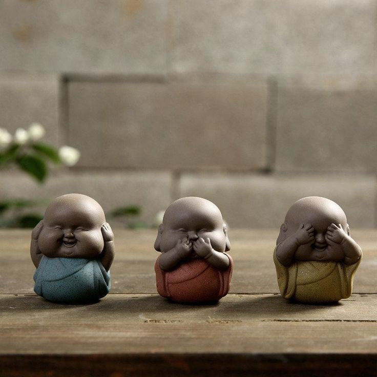 """Express yourself with our adorable and lovable Buddha Chubbies. These extra chunky mini-monks bring joy, laughter, and love into any space. Our three wise Buddha Chubbies embody the proverbial principle """"see no evil, hear no evil, speak no evil"""". Blue - Covering his ears, who hears no evil Red - Covering his mouth, who speaks no evil Yellow - Covering his eyes, who sees no evil"""