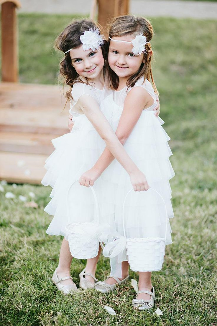 Adorable flower girls in white ruffle dresses from Stardust Celebrations. Wedding by Grit + Gold. Photo by Lauren Peele Photography. #wedding #flowergirls #white