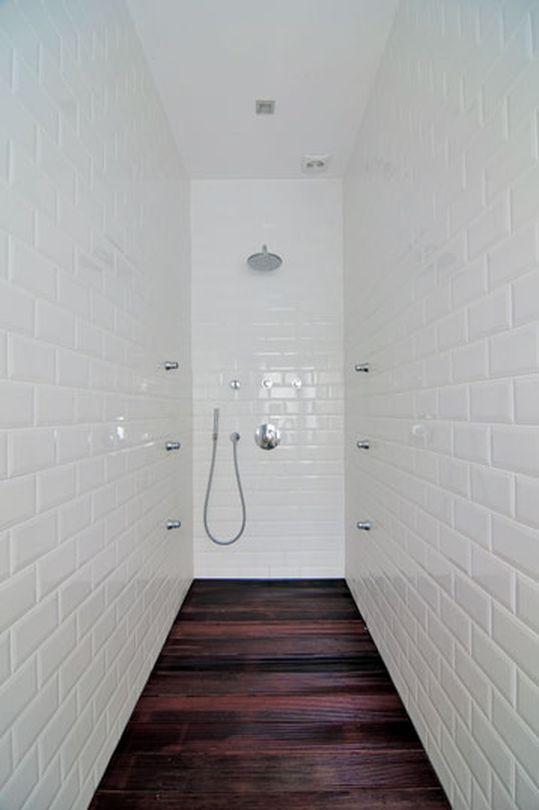 wooden floor with metro tiles walls