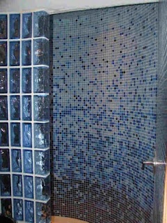 mosaic glass tiles in a gradient make this whole wall a work of art