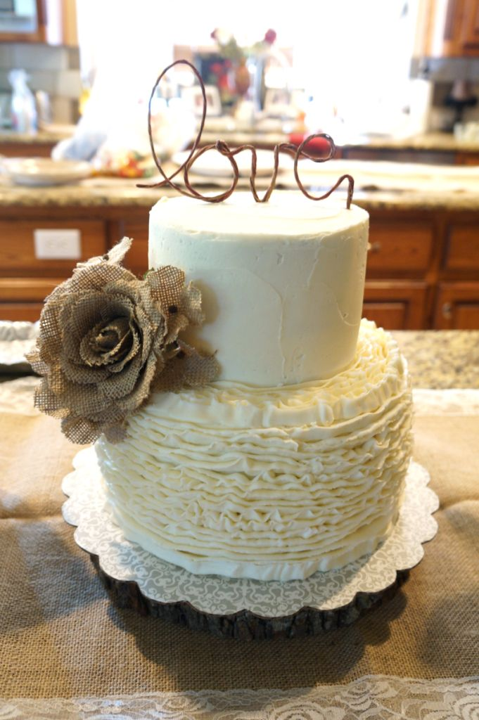 this simple and adorable bridal shower cake with burlap flowers a