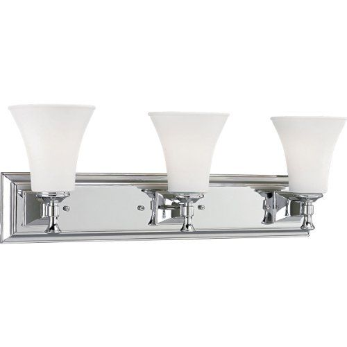 Progress Lighting P3133-15 3-Light Bath Fixture, Polished Chrome by Progress Lighting. $89.97. From the Manufacturer                Modern and architecturally inspired, the crisp geometric lines of the Fairfield Collection are graced by soft white conical glass shades. Three-light bath fixture. Uses (3) 100-Watt medium base bulbs 25-Inch Width x 9-Inch Height Fixture mounts in up or down position                                    Product Description                Pr...
