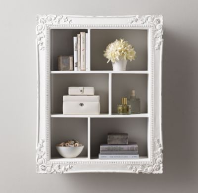 Find frames from a thrift store, attach wood to all sides, paint and hang on wall. New and creative shelves ! Vintage Hand-Carved Display Shelf