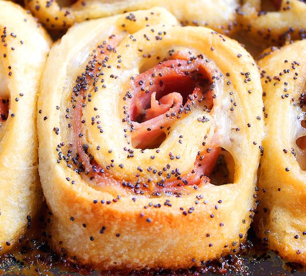 These Baked Ham and Cheese Rollups, are an easy appetizer or dinner recipe that tend to always be a crowd favorite. They are made with crescent dough, Boar's Head SmokeMaster™ Black Forest Ham, and swiss cheese, then topped with a delicious mustard glaze.
