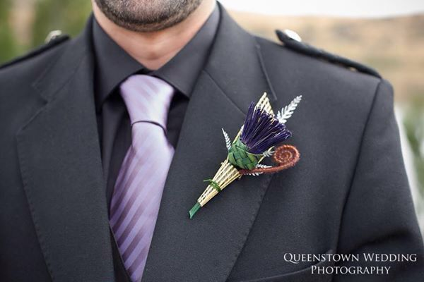 Thistle buttonhole by Flaxation. Created to last with silver fern and koru. Deliver worldwide. www.flaxation.co.nz