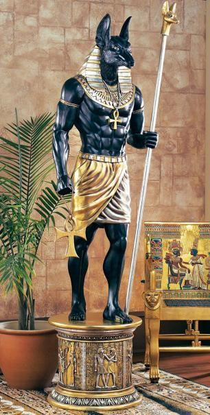 Anubis - The Egyptian God Anubis, God of cemeteries and embalming; Funerary God, takes form a jackal; guards & protects the dead; Ruled the underworld prior to Osiris; holds the scales the measure the heart against the feather upon death.