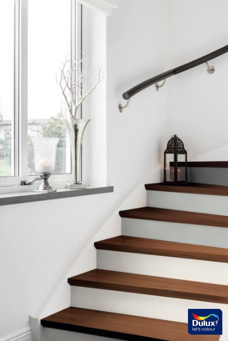 Painting stair-risers is an interesting way to introduce colour into an otherwise white hallway.