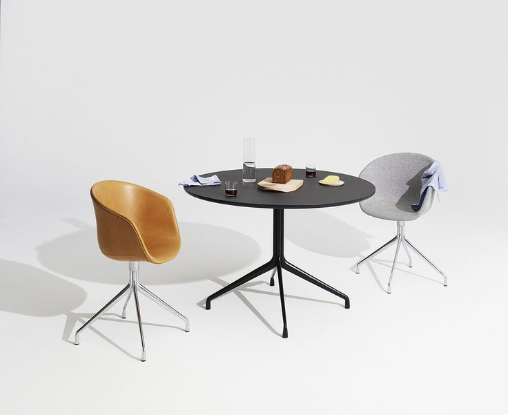 HAY AAT20 table with everyday items and stylish chairs