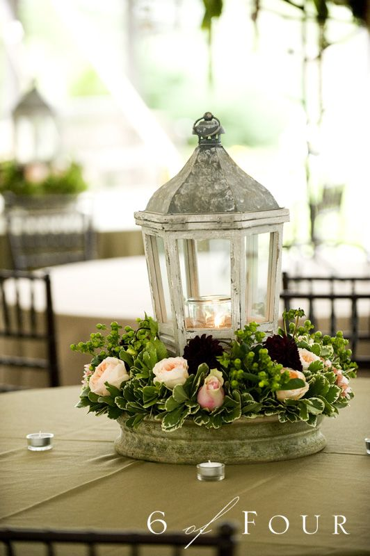 Love the way these lanterns are arranged with the flowers.. rustic yet elegant!