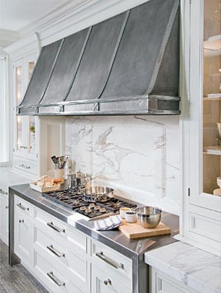 Love the wrap around stainless for stove area and hood by O'Brien Harris in Chicago