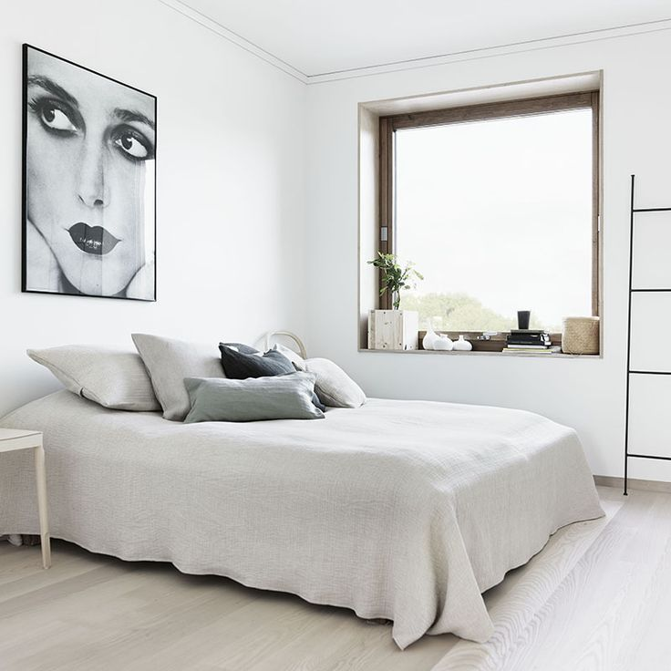 minimal bedroom in neutral tones.