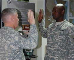 U.S. Army Maj. Gen. Wayne W. Grigsby, Jr., Combined Joint Task Force-Horn of Africa Commanding General, administers the officer's oath to 2nd Lt. Komi Afetse, a U.S. Army Civil Affairs and Psychological Operations Command Soldier deployed to CJTF-HOA, during a ceremony at Camp Lemonnier, Djibouti, Feb 14, 2015. Afetse immigrated to the U.S. from Togo and received his commission through the U.S. Army Reserve Officer Accession program, or direct commission (courtesy photo)