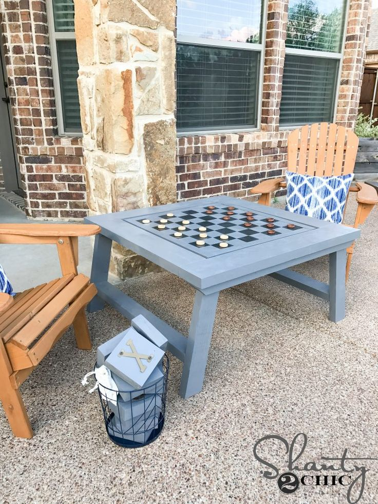 DIY Outdoor Game Table! One side has tic-tac-toe, the other side has checkers! Easy to follow free plans and tutorial at www.shanty-2-chic.com