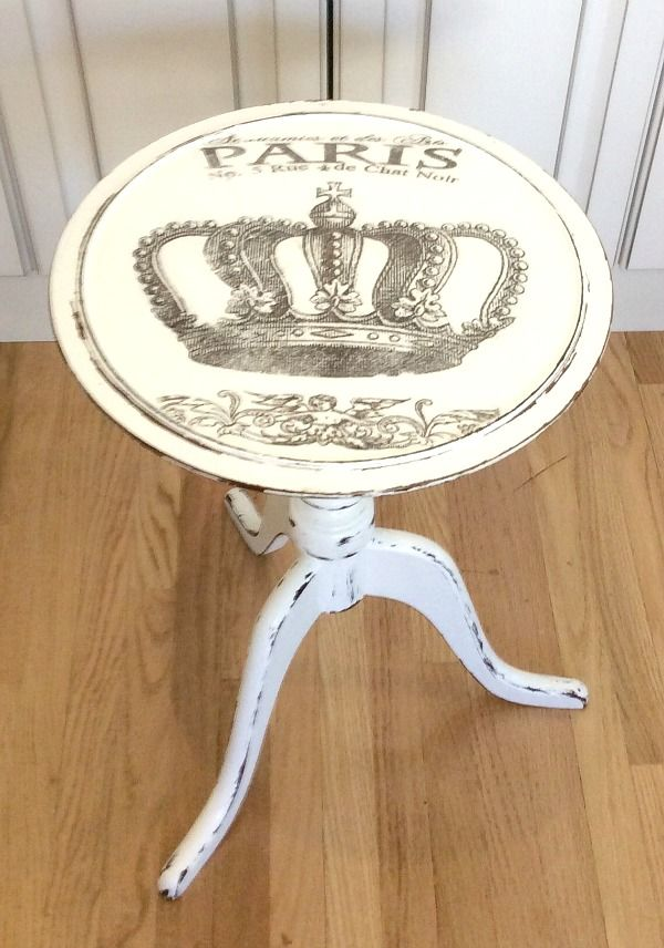 A beautiful DIY French Side Table! Rose first painted the table with off white chalk paint, and then used sandpaper to distress a bit.  After that, she added the crown graphic to the top. Lastly, she added a coat of varnish to protect the table from normal wear and tear. - See more at: http://thegraphicsfairy.com/diy-french-side-table-reader-feature-4/#sthash.qaovx3Eo.dpuf