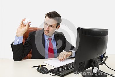 Disappointed manager throwing a crumpled paper in front of his computer at office.  Download Disappointed Manager Stock Photo for free or as low as 0.69 lei. New users enjoy 60% OFF. 19,865,028 high-resolution stock photos and vector illustrations. Image: 28497590