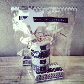 Inspiration: mini adventcalendar - washi tape tealights numbered 1 to 4 and matching washi tape matchbox in a clear gift bag decorated with a paper star and embossed labelmaker tape.