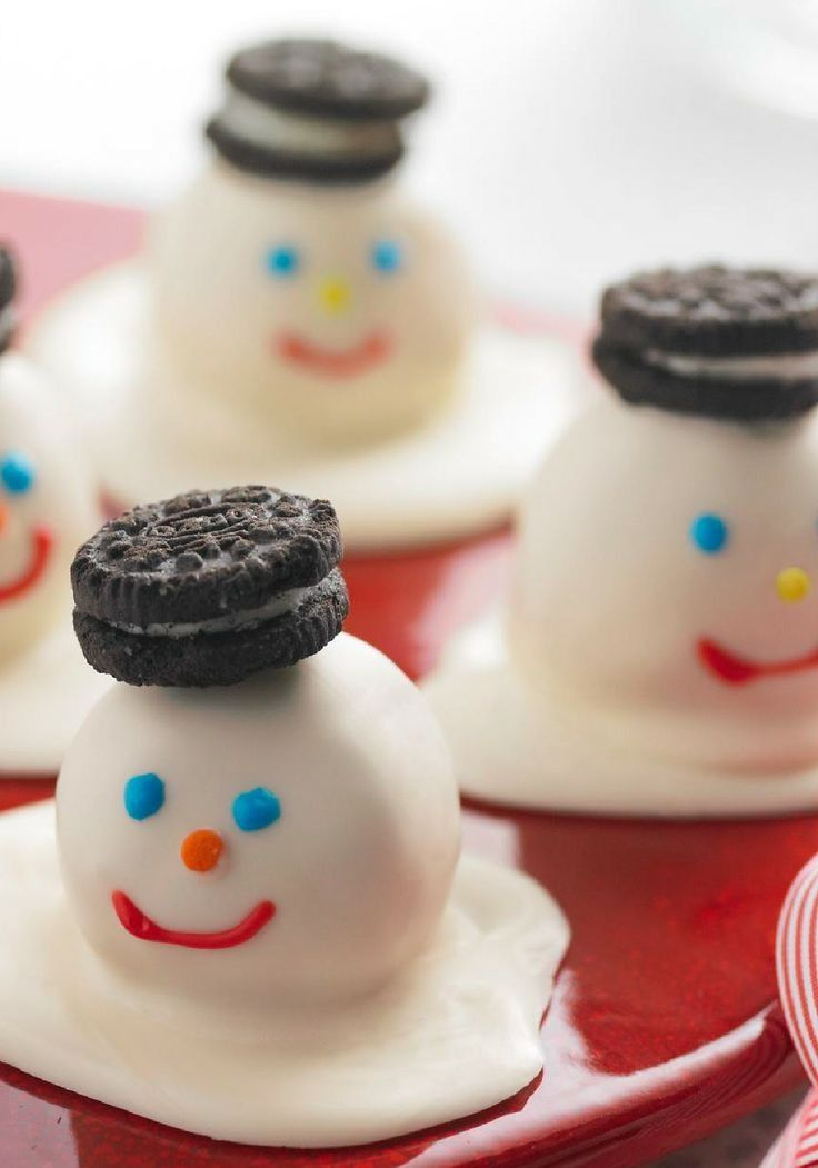 Melting Snowmen Cookie Balls — The cookie hats. The piped icing faces. The white chocolate that looks like melting snow. These snowman cookie balls are (almost) too cute to eat!