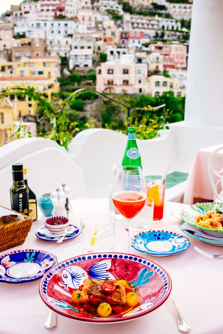 The view of Positano from Le Sirenuse in Positano Italy, The Taste SF #positano #pink #restaurant #amalficoast #italia #prettycities #thetastesf
